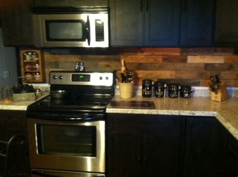 Wood Backsplash Kitchen Pallet Backsplash In Our Farm House Kitchen Highlighted By White And Black Countertops And