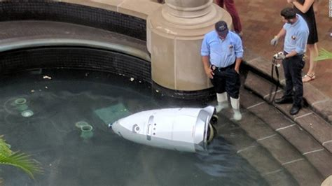 security robot in critical condition after nearly