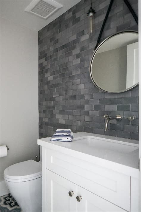tile accent wall bathroom black and white hexagon floor tile wood floors