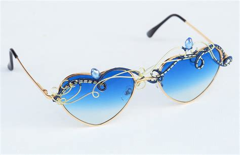 blue wire wrapped sunglasses by ianirasartifacts on