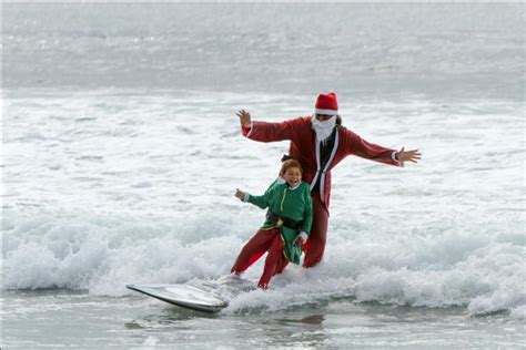 santa on surfboard the ritz carlton laguna niguel raises funds in support of children with autism