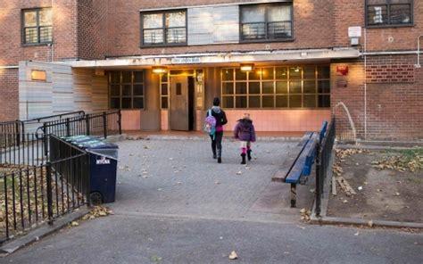 pink houses brooklyn neighborhood cop watches focus eyes and lenses on nypd al jazeera america