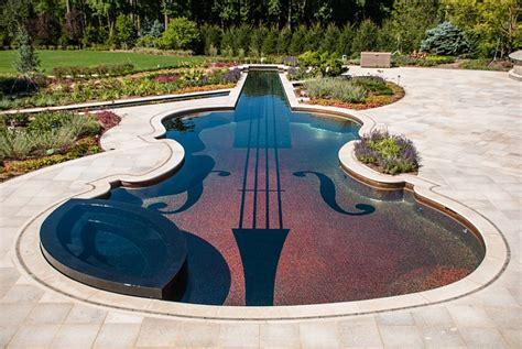 posh enough swimming pool shaped as a stradivarius violin