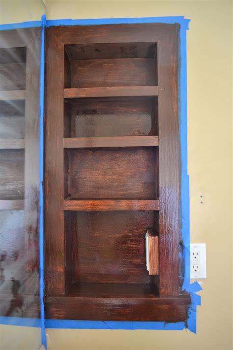 between the studs storage cabinet between the studs storage adding more storage to the