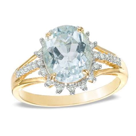 oval aquamarine and 0 11 ct t w ring in 10k gold