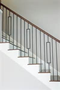 modern banister styles this staircase uses high quality wrought iron balusters to