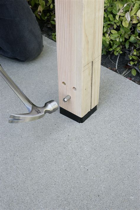 install l post concrete diy post base lets you hide the hardware diy done right