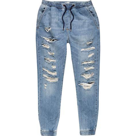 light blue jean joggers river island light wash denim ripped drawstring joggers in