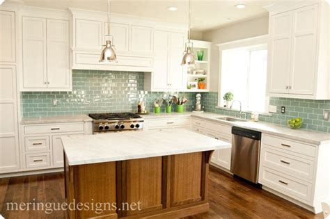 blue glass subway tile backsplash brown wood island and