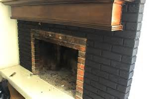 For this old outdated fireplace makeover this painted brick fireplace