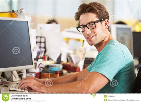 mens office desk man working at desk in busy creative office royalty free