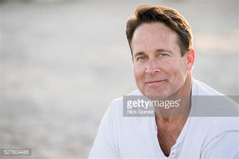 how can a 50 year old man look younger portrait of handsome 50 year old man stock photo getty