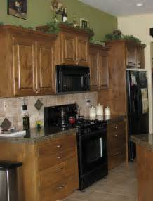 Black Kitchen Cabinets What Color On Wall by Radiant Rooms