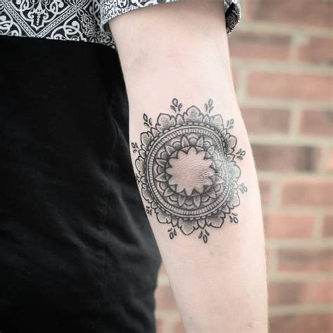 fantastic mandala flower tattoo on right elbow