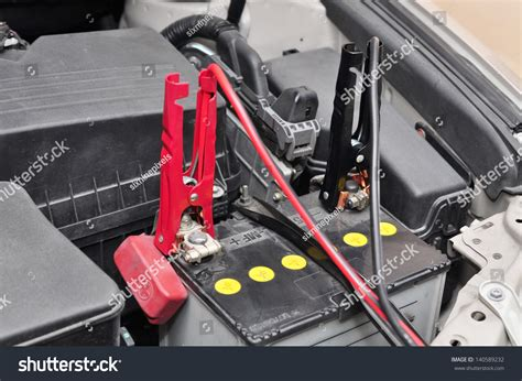 charging your car battery with a charger car battery charging stock photo 140589232