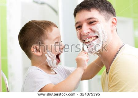 son in bathroom father and his kid son playing in bathroom child boy