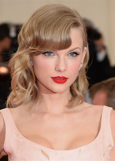 elegant hairstyles with bangs taylor swift elegant medium wavy hairstyle with bangs for