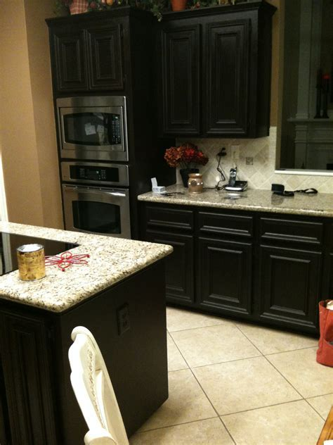Small Kitchen Spaces With Black Color Staining Oak Kitchen Cabinet With Granite Countertop And