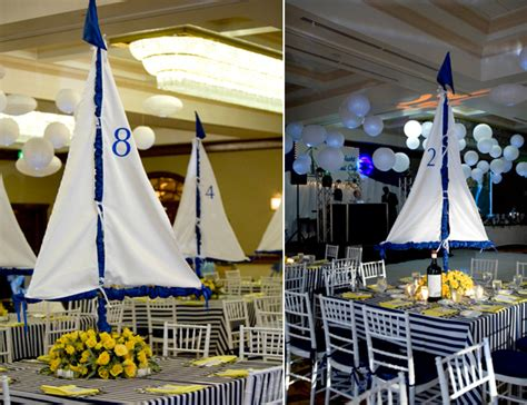 Sailboat Centerpieces Nautical Theme - custom designed centerpiece with table number on the sail set on a bed of yellow roses event