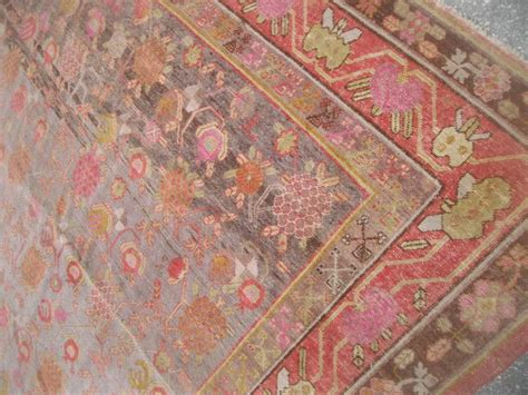 rug band antique khotan rug with eight band border in browns and oranges for sale at 1stdibs