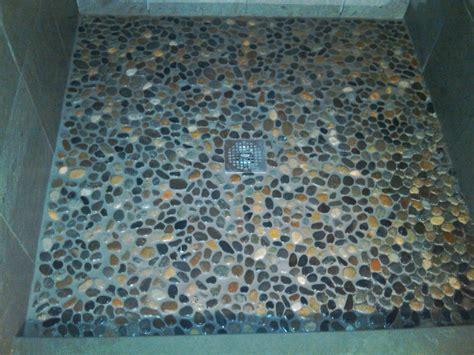 river rock bathroom floor tile how to tile a shower floor using river rock gentlemint