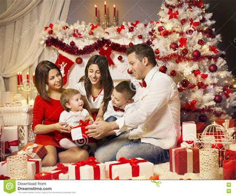 family christmas tree jarrettsville family opening magical present royalty free stock photography cartoondealer