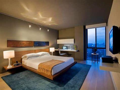 modern bedroom photos hgtv modern taupe bedroom with blue plush rug hgtv