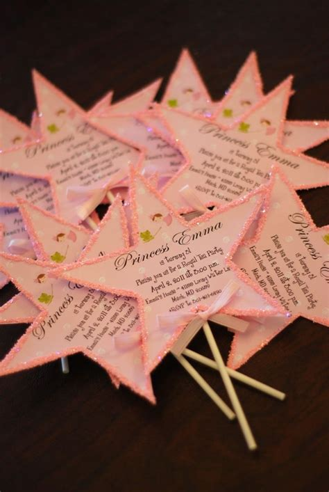 princess birthday party invitation with pink crowns and elegant