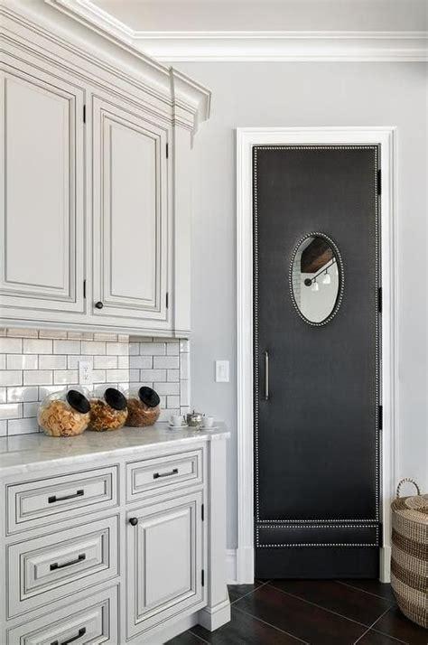 black upholstered swinging pantry door kitchens
