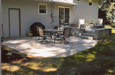 multi level stone patio  retaining wall landscaping