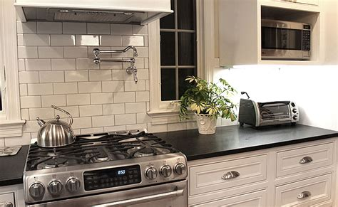 black countertop white subway tile backsplash