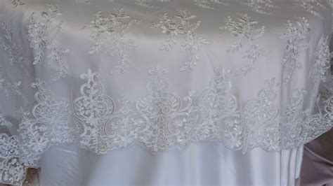 silver lace table overlay table linens linens and beyond beautiful