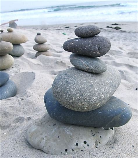 beach centerpiece with stacked rocks completely coastal