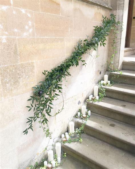 Foliage staircase garland and pillar candles   wedding