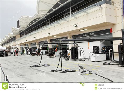 Pit Garage by Booms And Tyre Changing Assembly At Pit Stop Garage