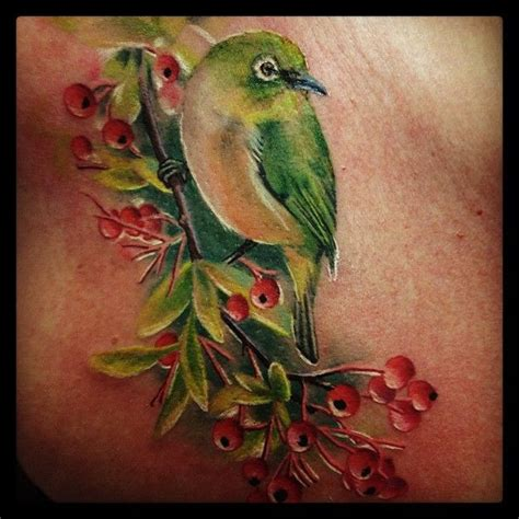 japanese white eye tattoo by caryl cunningham tattoo