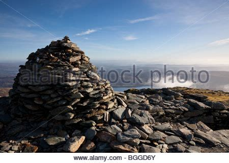 the cairn at the summit of coniston old man near coniston