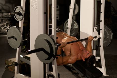smith decline bench press decline smith press exercise guide and video