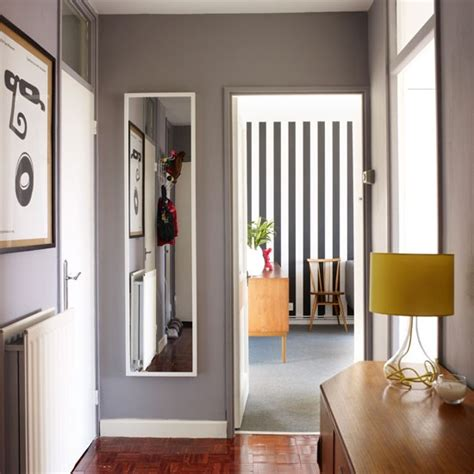 1970s inspired flat gray hallway paint walls and gray