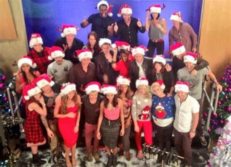 big reunion bands pose in christmas jumpers and hats for