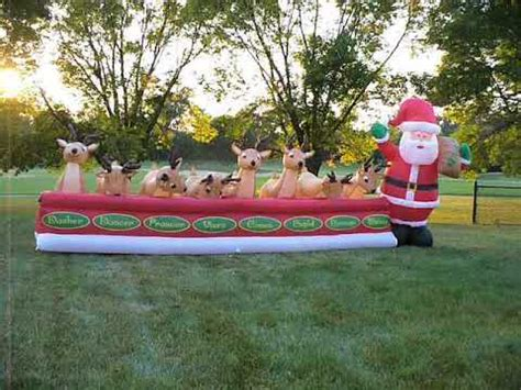 blow up santa in a boat shopchristmasinflatables animated reindeer feeding
