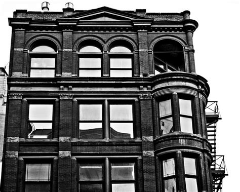 black and white brick apartment building photograph by alanna pfeffer
