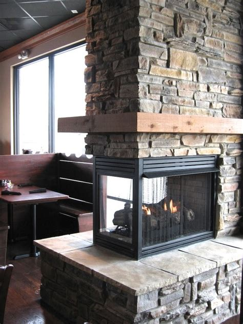 remodeling your two story fireplace north star stone ledge stone fireplaces album 2 traditional living room