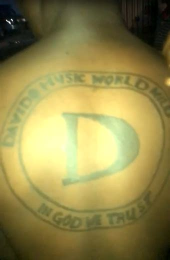 download awww olamide gets a new tattoo photo mp3 video fan tattoos davido s music worldwide dmw logo on his back