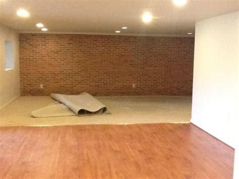 laminate flooring basement   Nusite Waterproofing Contractors