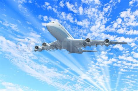 Fly To The Sky 1 2 large passenger airplane flying in the sky stock photo colourbox