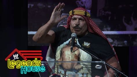 wwe legends house the iron sheik takes the podium wwe legends house june