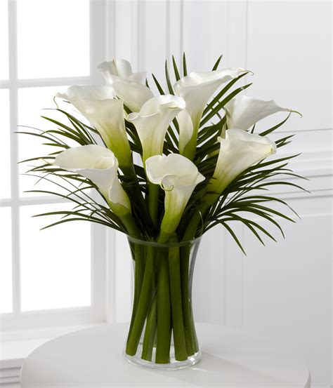 white calla and palm vase