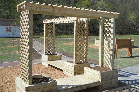 build an arbor trellis how to build a trellis planter bench kaboom