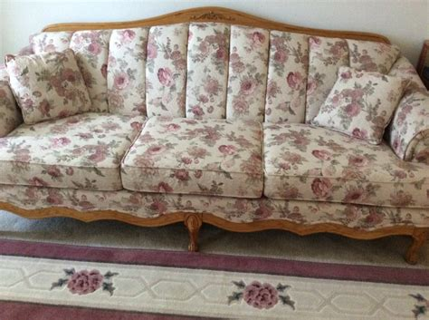 beautiful floral sofa with oak trim barely used